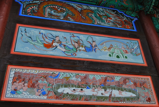 Horizontal rectangular paintings adorning the sides of the Beopjusa Buddhist Temple Complex showing deities and dragons.