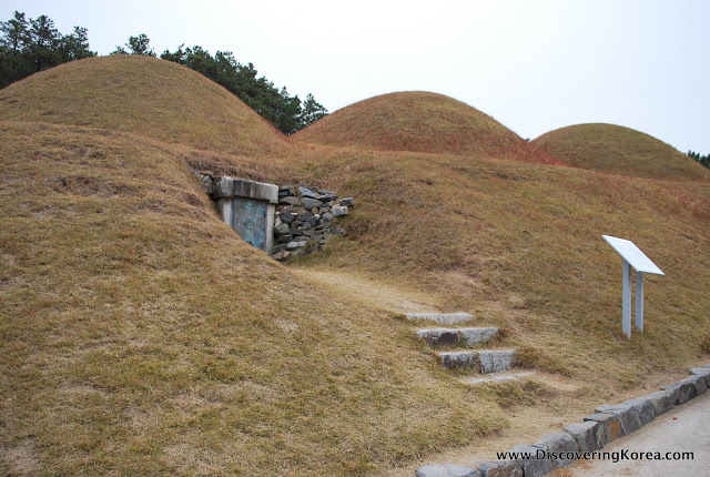 Three mounded royal Baekjae royal tombs on a hillside near Gongju city, South Korea.
