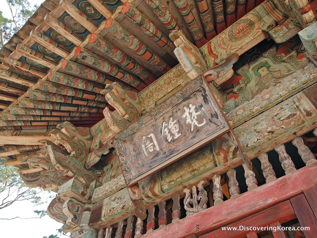 Faded wood carvings with ornate detailed painting.