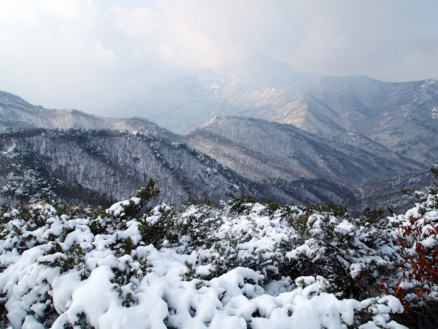 Snow on the slopes of Dobongsan, with a view over the the mountains.