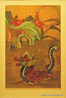 A Korean painting depicting a dragon, with a rabbit on its back.