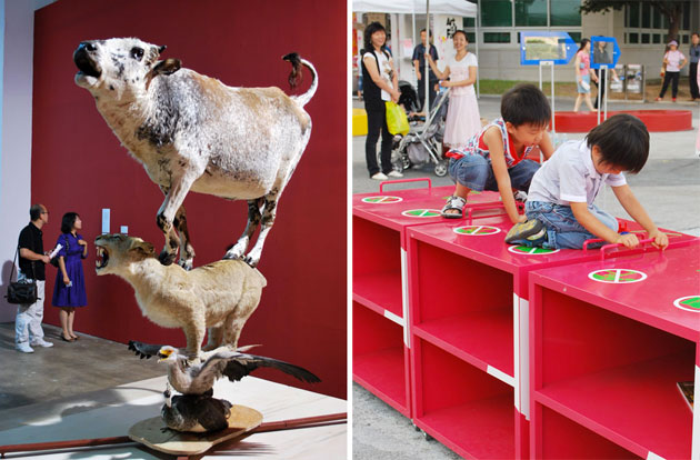 Side by side images from the Biennale exhibition at Gwangju. On the left is a taxidermy statue of a cow on top of a lioness, on top of an eagle, with a peafowl at the bottom, against a red wall. To the right, two children playing on a red block shelf, with adults watching behind.