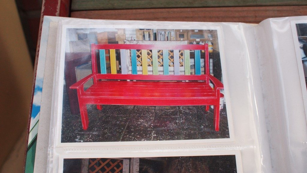 Hongdae furniture street catalogue, a picture showing a red bench with multicolored back slats, in a plastic folder.