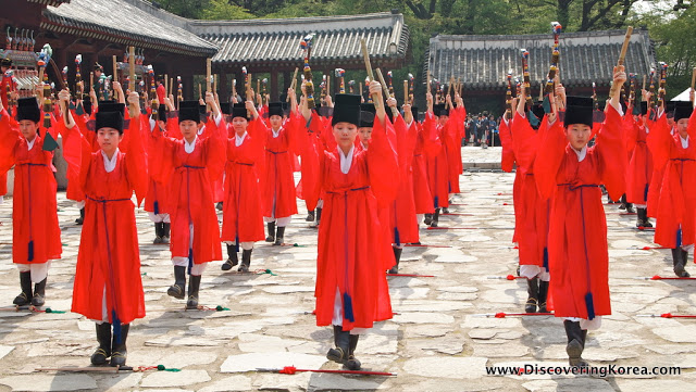 Outside the Jongmyo Royal Shrine, five lines of ladies, dressed in red robes, at Jongmyo royal shrine.