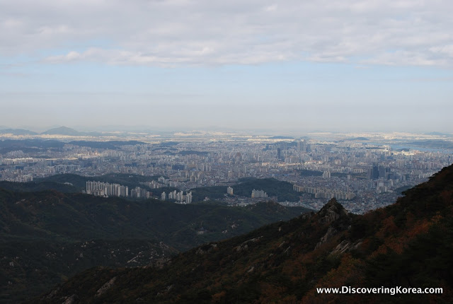 View over soft focus city from Gwanaksan mountain.