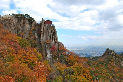 Autumn colored forest on the rocky slopes of Gwanaksan mountain in Korea.