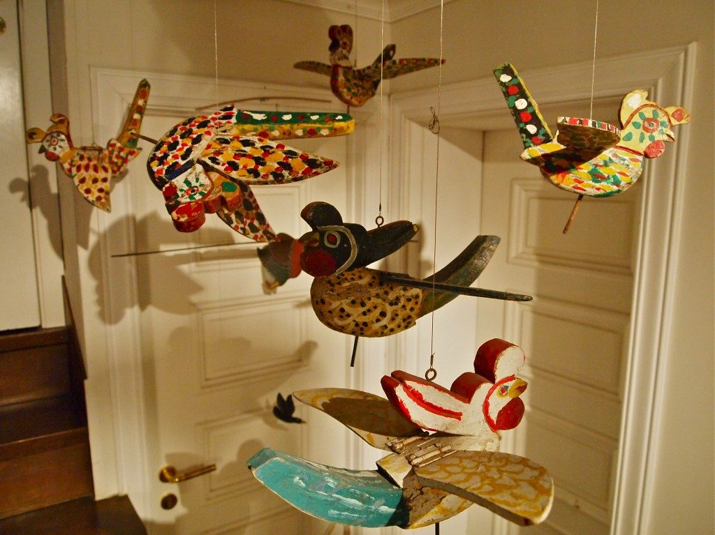 Wooden bird carvings, with movable wings hanging from the ceiling at Musee Shuim.
