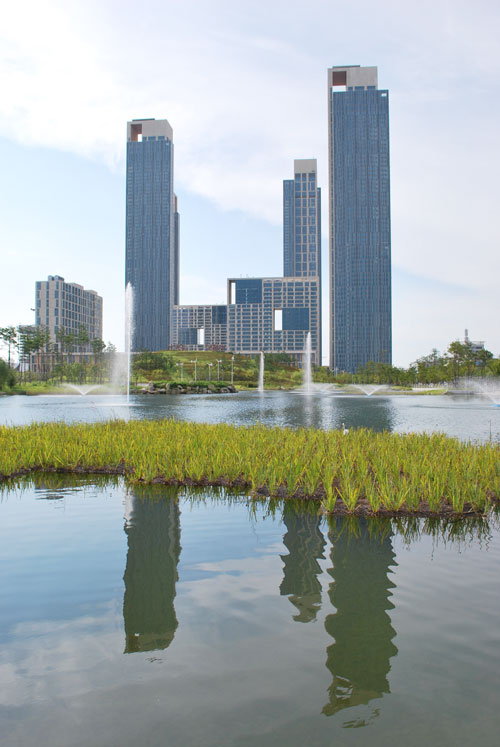 Skyscrapers in Incheon, reflecting on a body of water