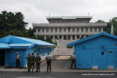 Two blue buildings flank a larger building in the Joint Security Area of the DMZ.