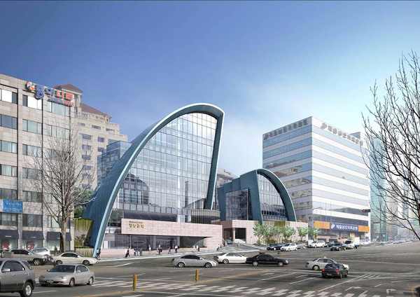 Looking across a wide street, with a pedestrian crossing, to a semicircle glass-fronted building of the Jangchung church. To the left of the frame is a block building, to the right is a glass office block. A blue sky in the background.