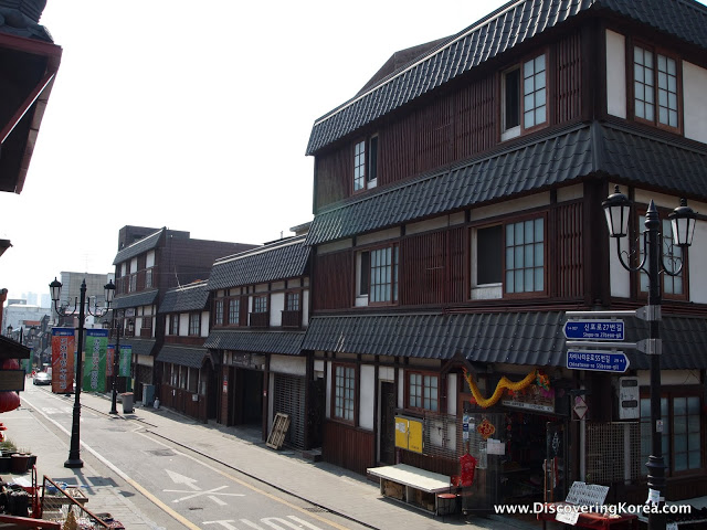Japanese-style buildings, brown latticed exterior, on a street in Incheon.