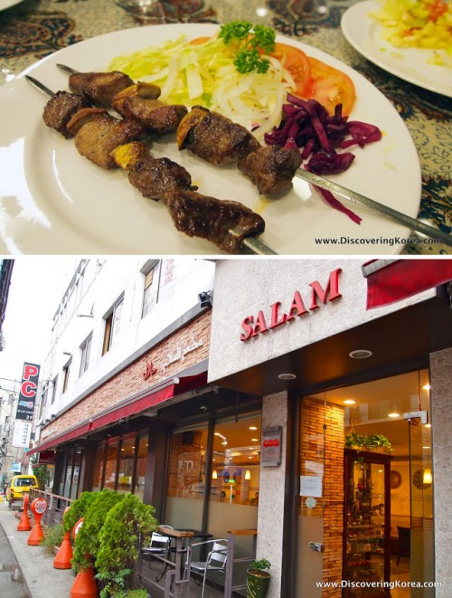 Two images, the top one showing meat on skewers with salad garnish, on a white plate on a floral table. The bottom image is of the outside of a restaurant, in red and white, with green ornamental trees and chairs outside.