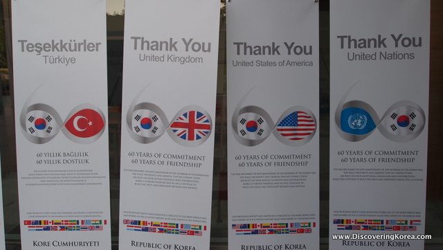 Four vertical cards with the text 'Thank You' and on each a Korean flag and a foreign flag.