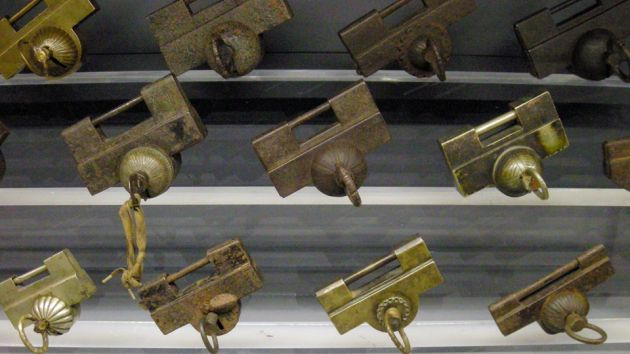 A collection of rectangular shaped padlocks, from the Lock museum in Seoul. Showing different designs in bronze.