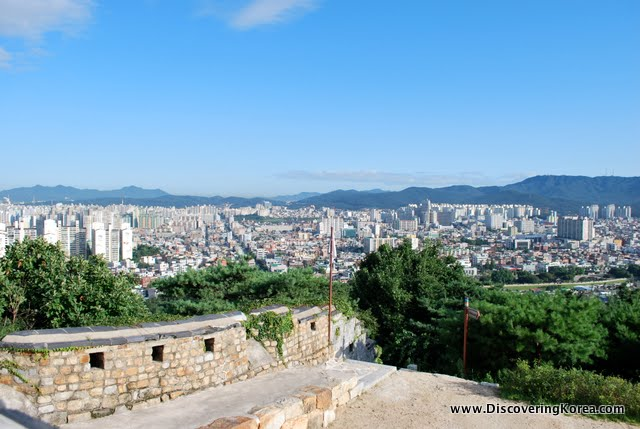 City view in bright sunshine from the wall of Suwon Hwaseong fortress.