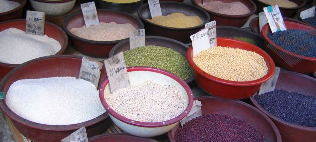 A close up of little bowls containing different seeds and powders in a shop in Daegu, Korea.